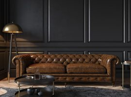 classic brown leather lounge against a dark wall